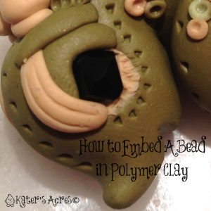 Mini-Tutorial How To Embed a Bead Into Polymer Clay by KatersAcres