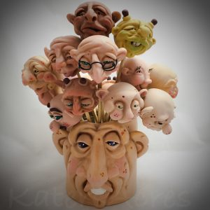 Face Vase by KatersAcres   Filled with custom sculpted faces made from polymer clay
